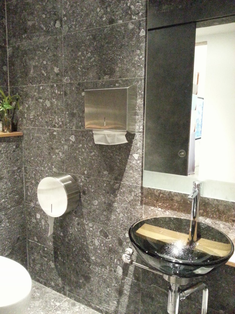 Wall and floor of bathroom, in stone tiled clad finish