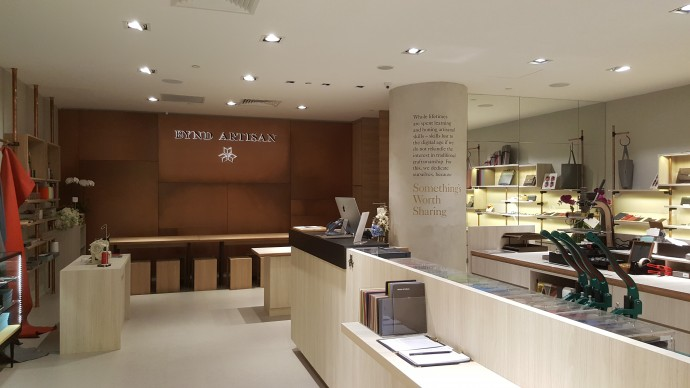 View of Interior of Bynd Artisan Raffles City Store - Copper Feature Signage Wall.